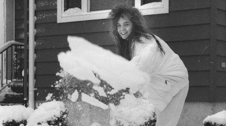 Dawn Hahn, 15, of Babylon, shovels the walk