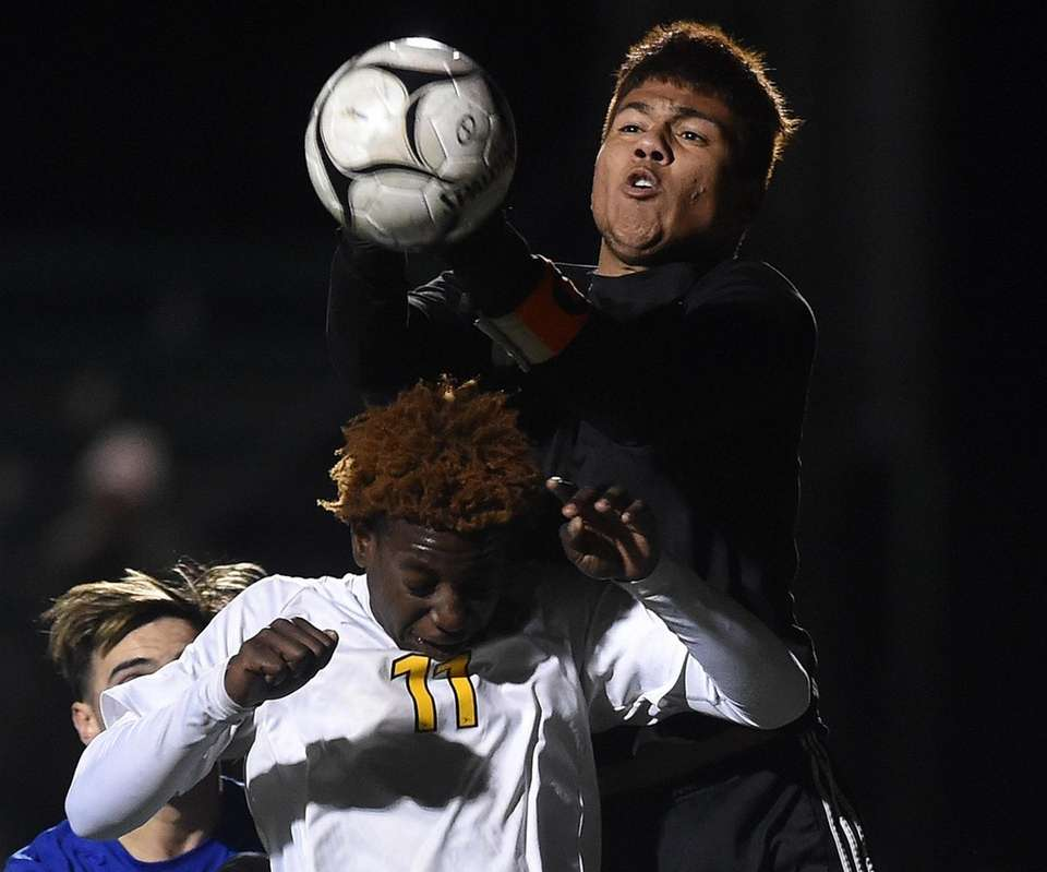 Endi Fernandez, Uniondale goalie, makes a save off