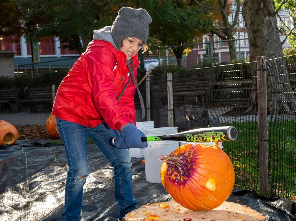 Donovan Kirsmer age 9, Brooklyn smashes a pumpkin