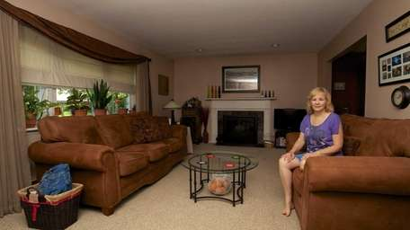 Donna O'Sullivan in the living room of her