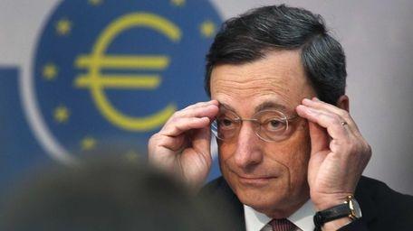 President of European Central Bank Mario Draghi adjusts