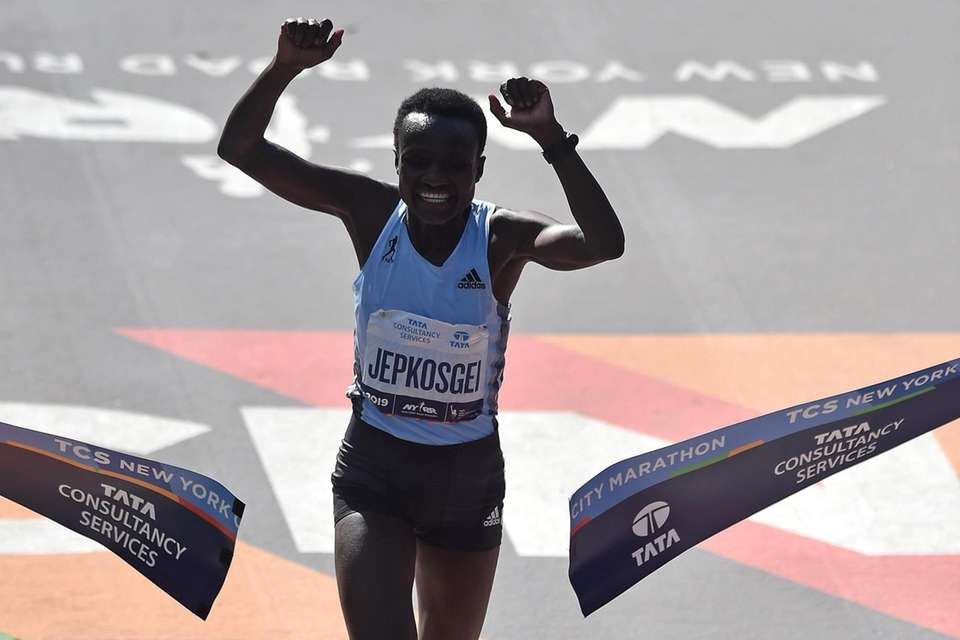 Joyciline Jepkosgei of Kenya crosses the finish line
