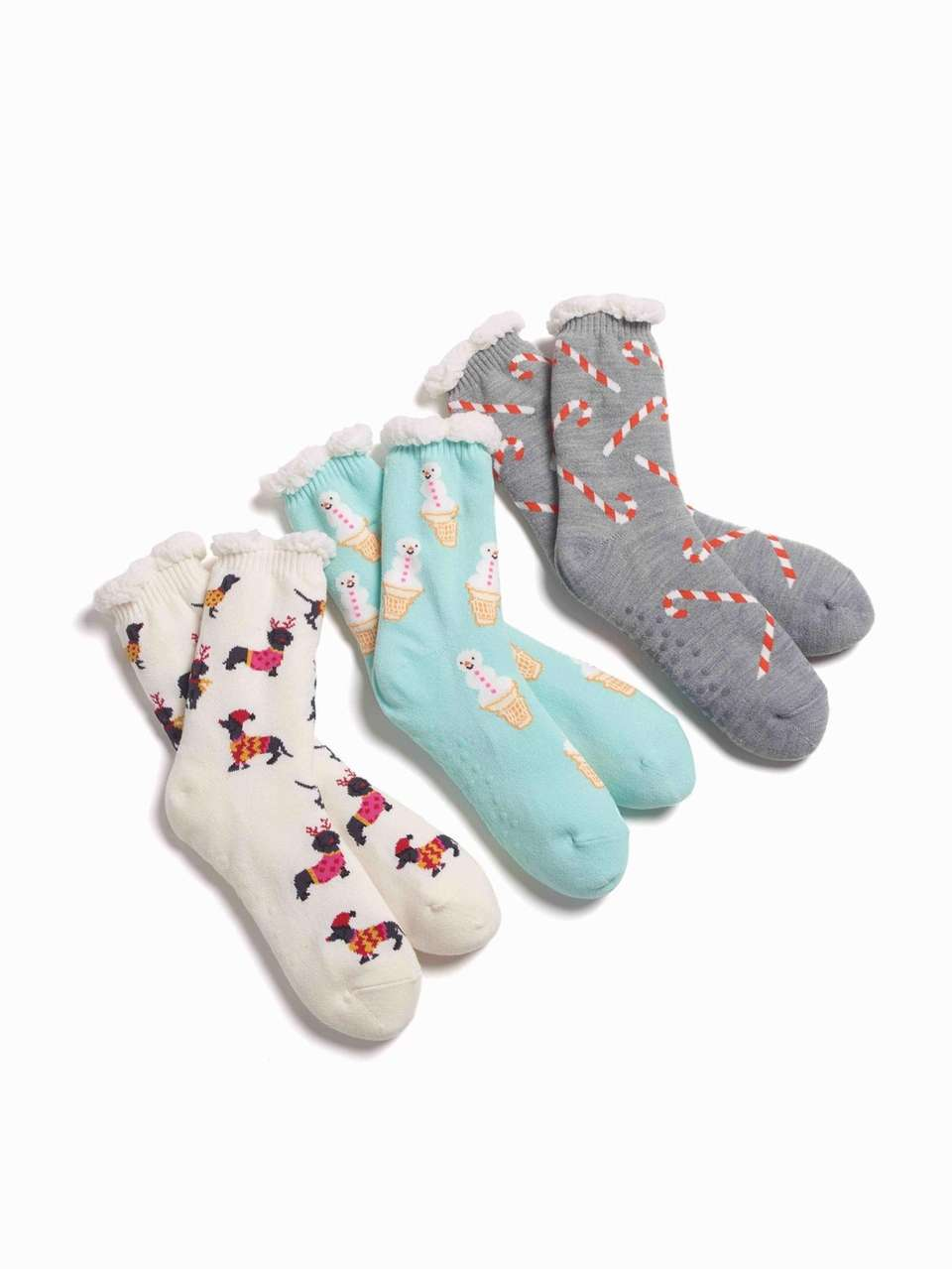 These festive soft-knit slipper socks feature a warm