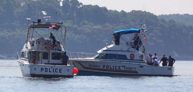 Police boats search for a capsized vessel about