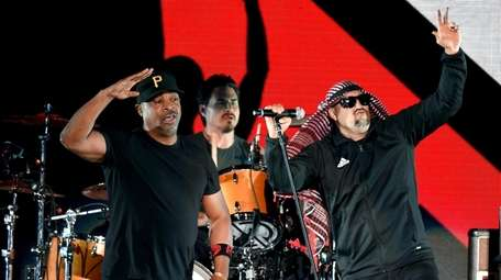 Rappers Chuck D, left, B-Real and drummer Brad
