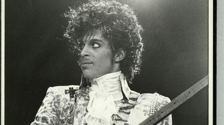 Prince plays guitar in Long Beach, California, during