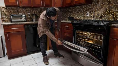 Ali Rizvi, of Woodbury, checks on his rental