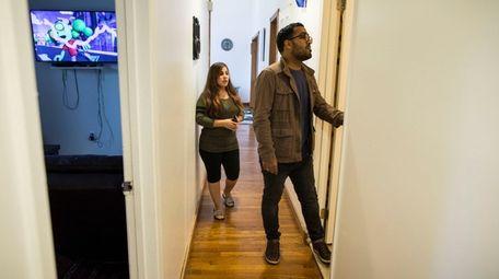 Ali Rizvi checks on his rental property in