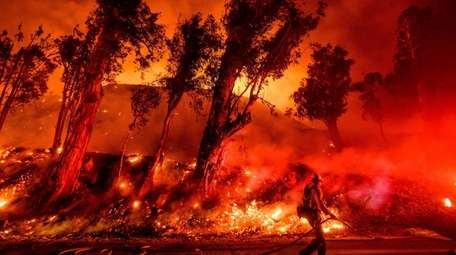 Firefighters in Santa Paula, Calif., on Friday battle