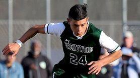 Brentwood midfielder Juan Gomez dribbles the ball between