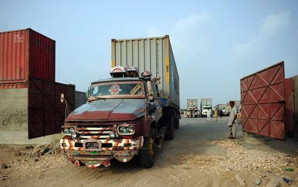 Container trucks carrying NATO supplies are parked at