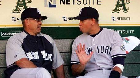 Reggie Jackson (L) and Alex Rodriguez. (Getty Images)