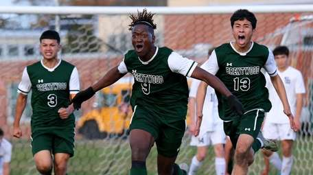 Brentwood forward Nathaniel Austin reacts after scoring the