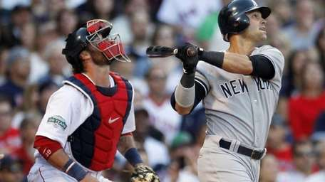 Nick Swisher, right, watches his grand slam in