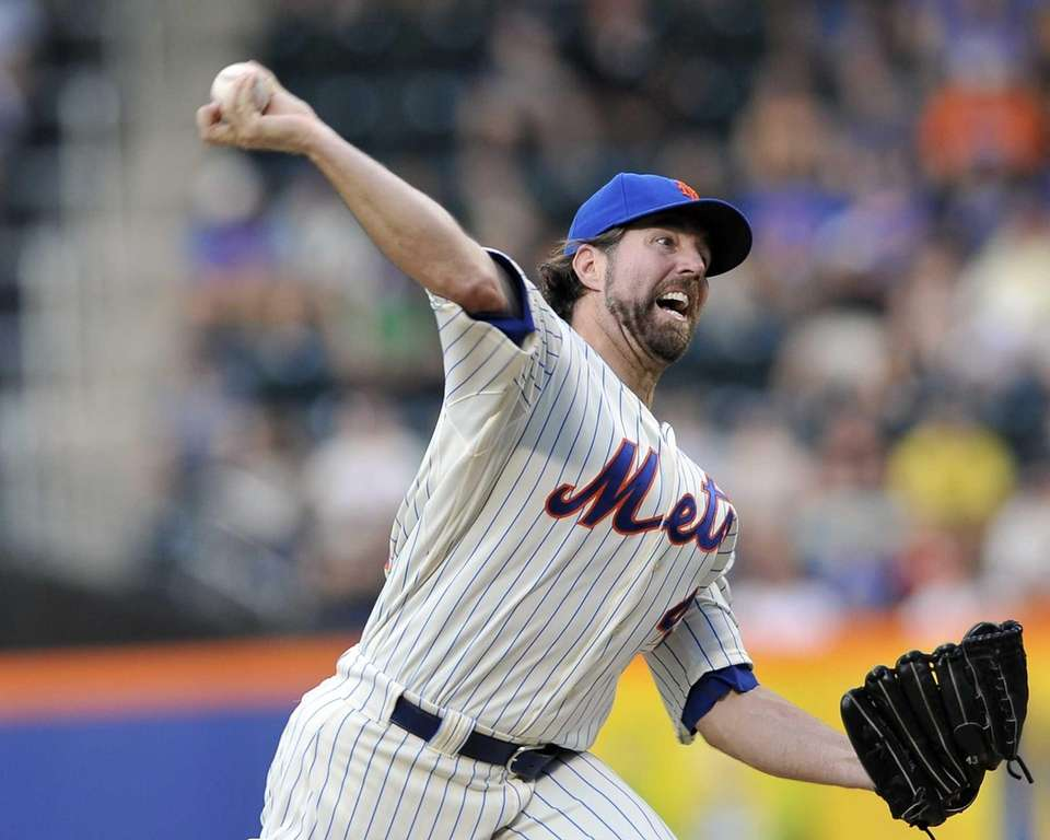 R.A. Dickey pitches in the first inning. (July