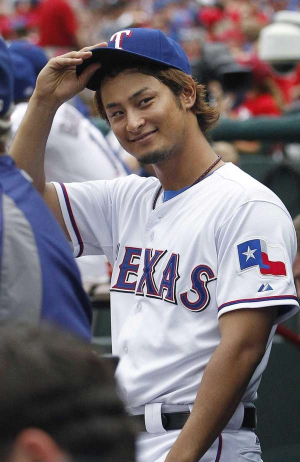 Texas Rangers pitcher Yu Darvish tips his hat