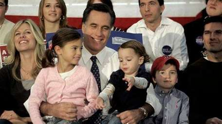 Mitt Romney, center, sits with his family from