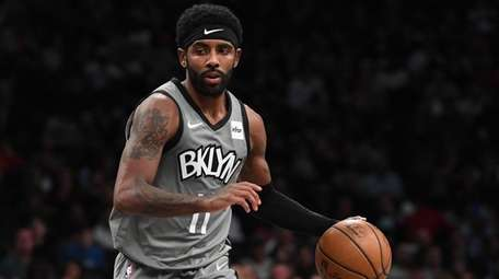 Nets guard Kyrie Irving controls the ball against