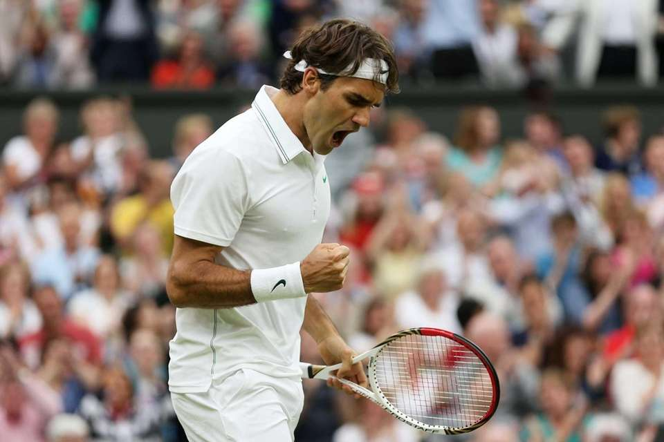 Roger Federer of Switzerland celebrates set point during