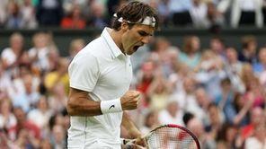 Roger Federer of Switzerland celebrates set point during