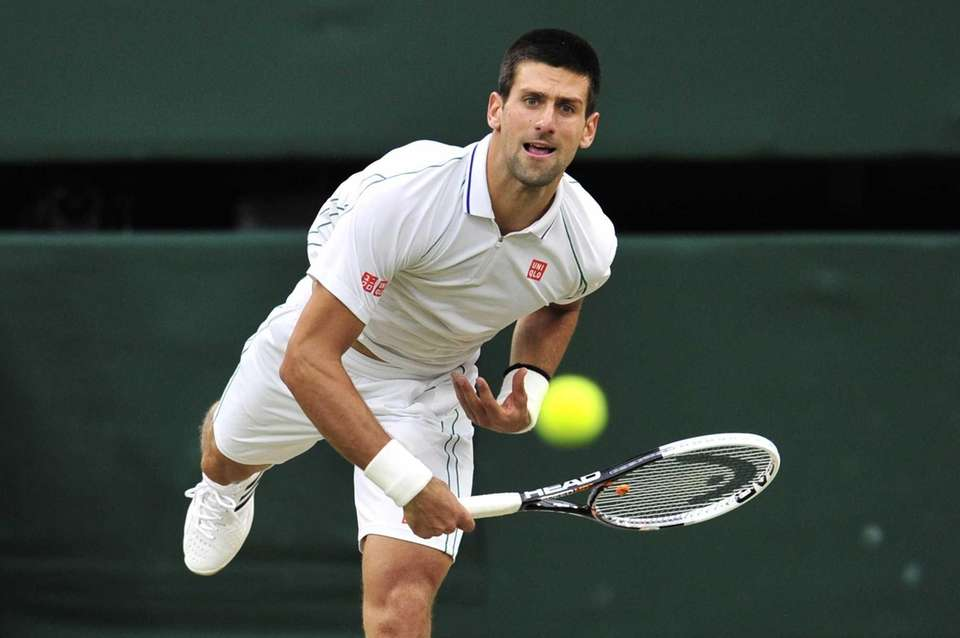 Serbia's Novak Djokovic serves during his men's singles