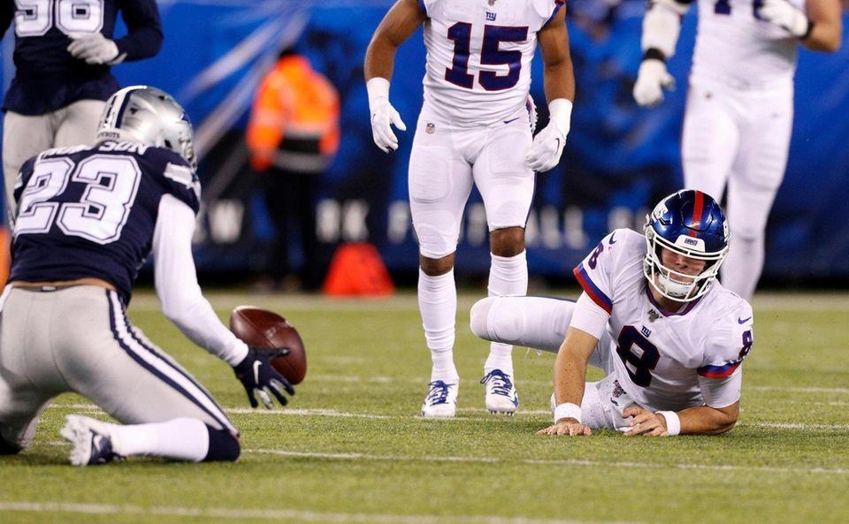 Daniel Jones of the New York Giants watches