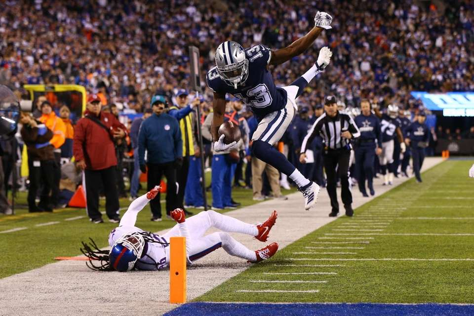Michael Gallup #13 of the Dallas Cowboys dives