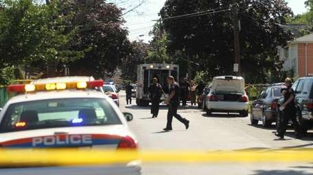 Nassau County police investigate a possible murder-suicide on