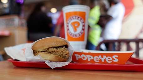 A chicken sandwich is seen at a Popeyes