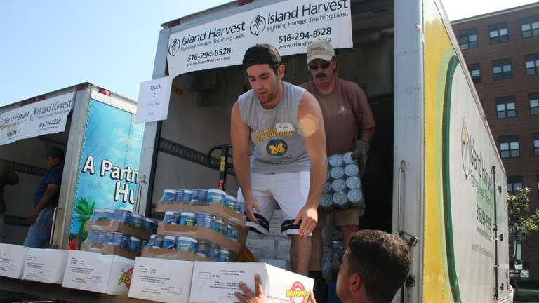 Island Harvest volunteers unloading donated food for distribution