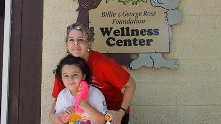 Katie Gallardo hugs her daughter Gina, a leukemia