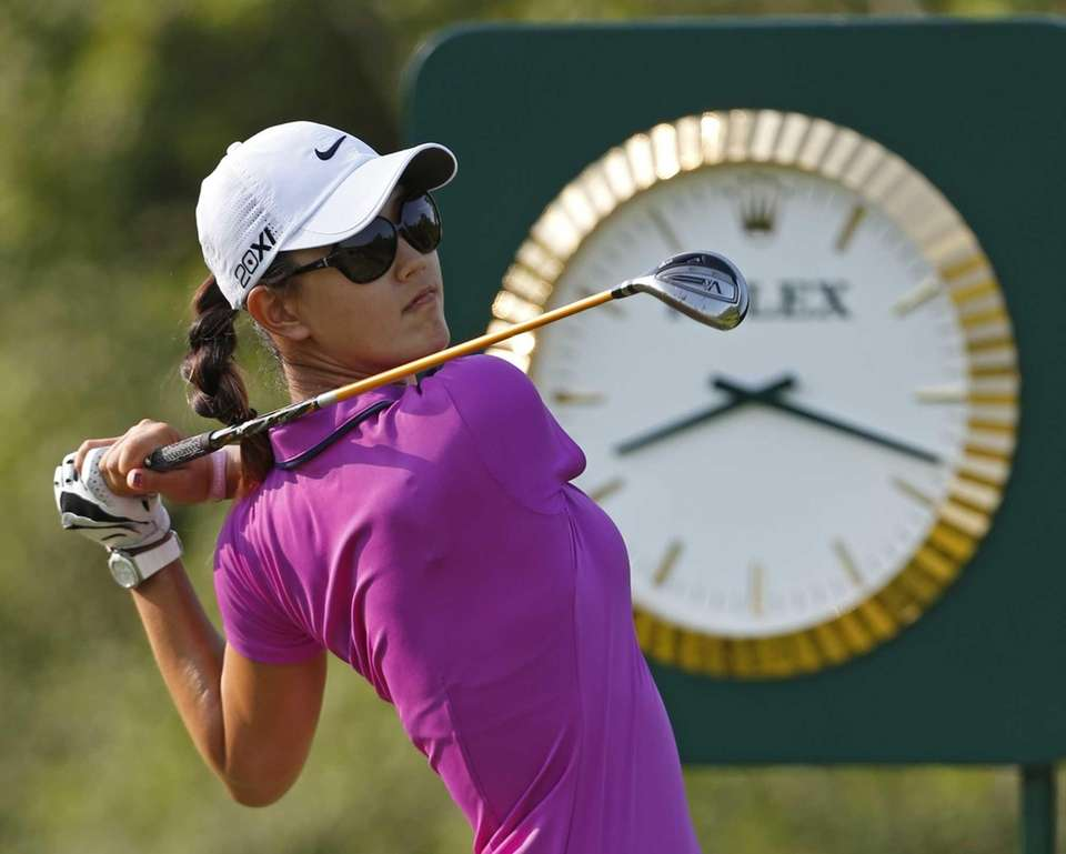 Michelle Wie watches her tee shot on the