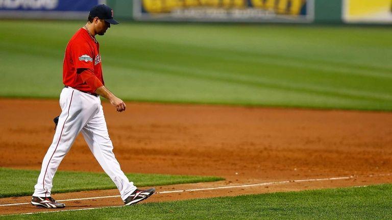 Josh Beckett walks off the field in the