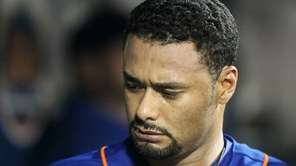 Johan Santana looks on in the dugout after