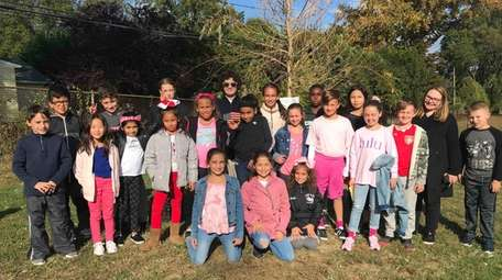 In Glen Cove, Connolly Elementary School students stand