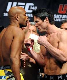 Anderson Silva, left, stares down Chael Sonnen at