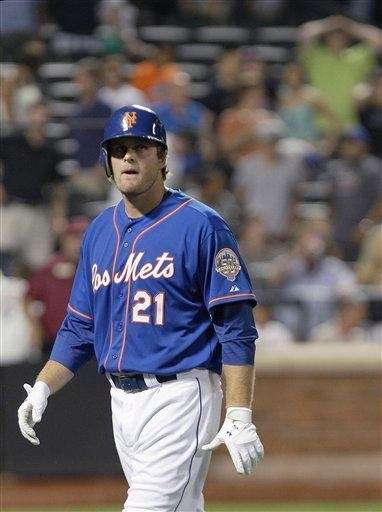 New York Mets' Lucas Duda walks away after