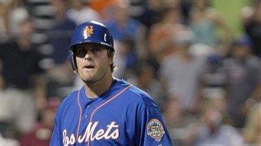 New York Mets' Lucas Duda walks away after