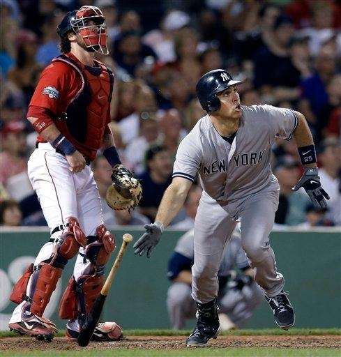 New York Yankees' Mark Teixeira watches his two-run