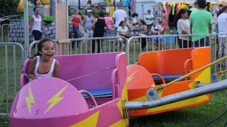 Stephanie Chapeton, 4, of Greenport laughs on one