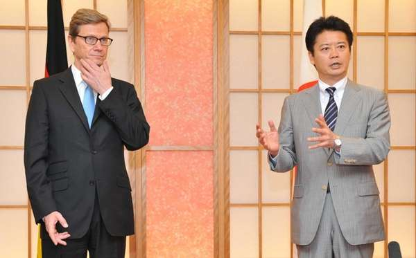 Germany's Foreign Minister Guido Westerwelle (L) and his