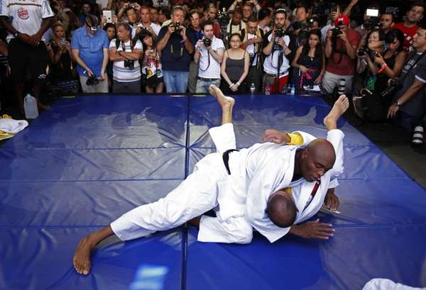 Anderson Silva, top, during an open workout for