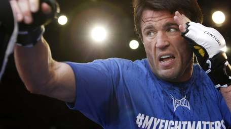 Chael Sonnen lands a punch during an open