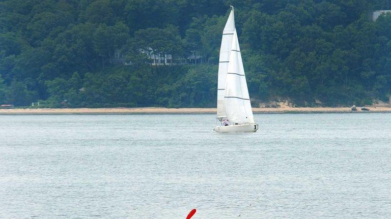 July 7, 2012: A kayaker keeps cool paddling