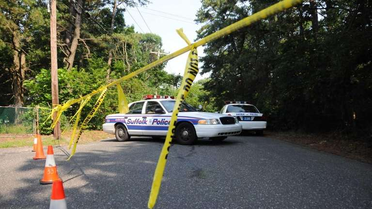 Police on Pinewood Avenue in Central Islip where