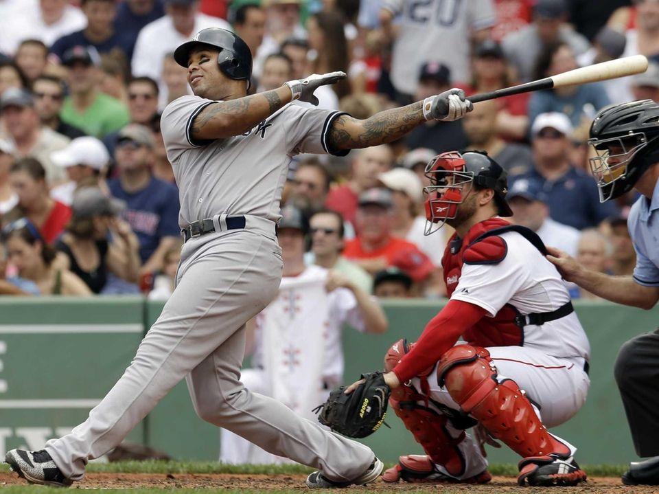 New York Yankees' Andruw Jones follows through on