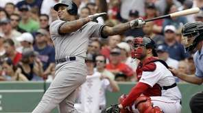 New York Yankees' Andruw Jones follows through on