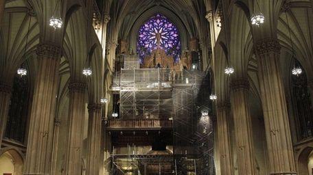 This photo shows scaffolding surrounding the choir loft