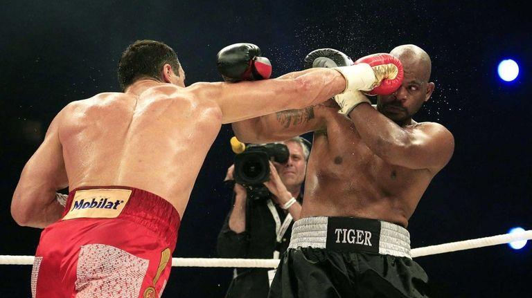 Heavyweight champion Wladimir Klitschko of Ukraine, left, fights