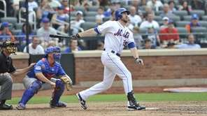 Ike Davis watches his third-inning two-run home
